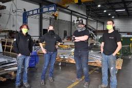 General Sheet Metal team members wearing face coverings, per COVID-19 regulations, in the warehouse