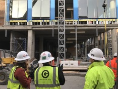 Engineers in hard hats and General Sheet Metal gear looking at architectural project