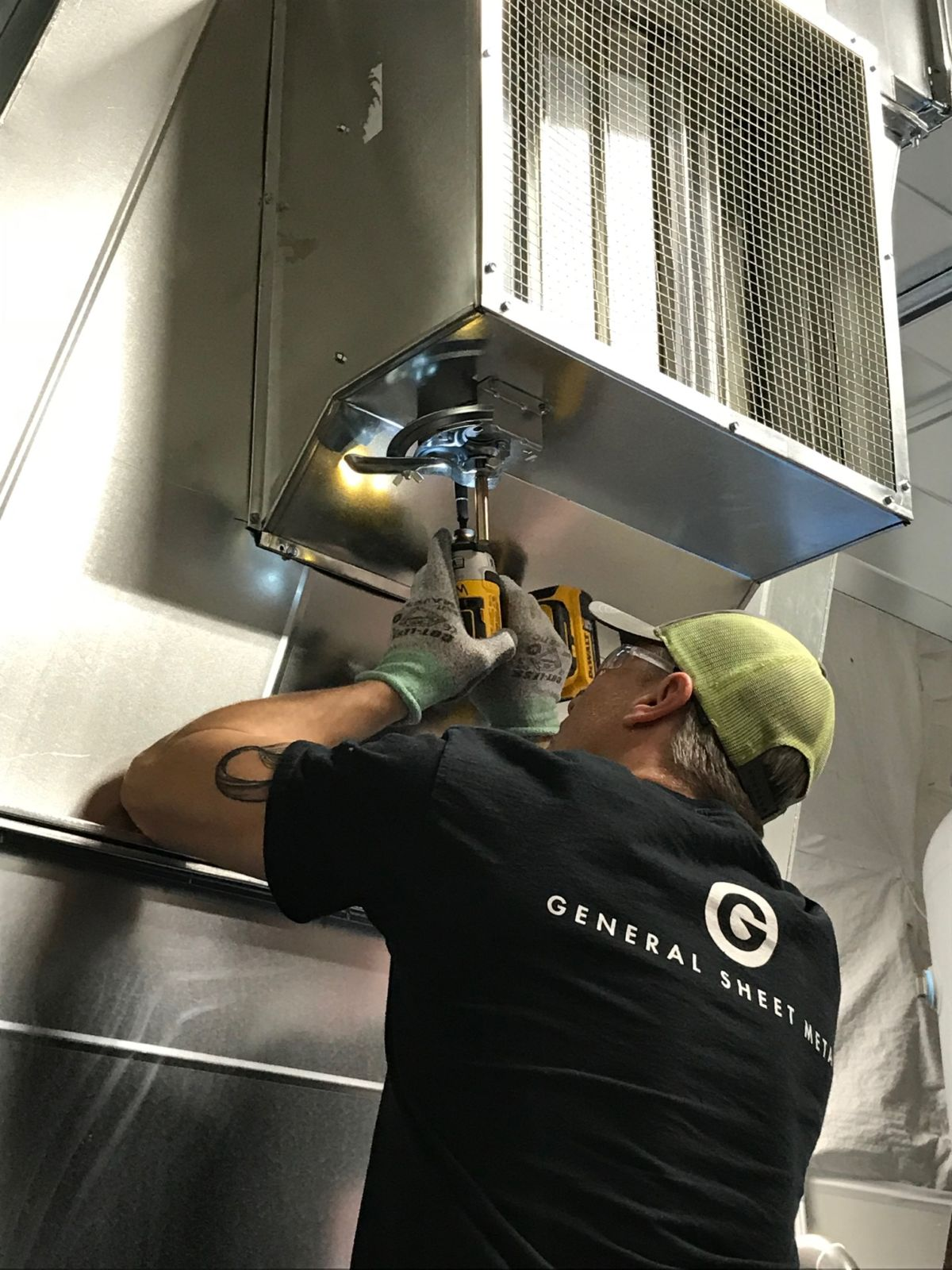 Man repairing ductwork