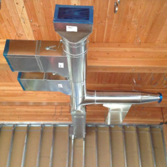 Silver mechanical ductwork in an open ceiling
